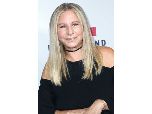 (Photo by John Salangsang/Invision/AP, File). FILE - In this Sept. 12, 2017 file photo, Barbra Streisand attends the Hand in Hand: A Benefit for Hurricane Harvey Relief in Universal City, Calif.  Streisand is giving an early thumbs-up to the remake of ...