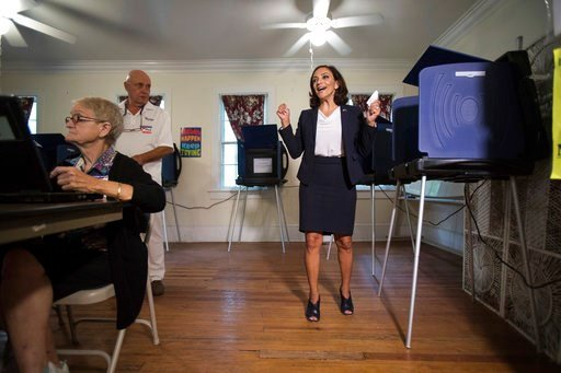 (Kathryn Ziesig/The Post And Courier via AP). South Carolina Rep. Katie Arrington, who is running for the first district of South Carolina, celebrates after casting her vote on Tuesday, June 12, 2018 at Bethany United Methodist Church in Summerville.