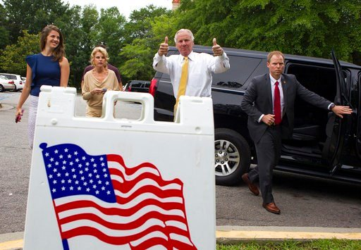 (Kevin Martin//The State via AP). South Carolina Governor Henry McMaster gives a thumbs up as he arrives to vote in the South Carolina Primary, Tuesday, June 12, 2018 at the Lourie Center in Columbia, S.C. Arriving with McMaster is his daughter, Mary R...