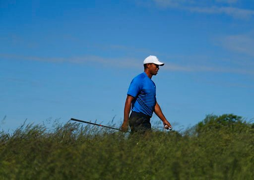 (AP Photo/Julie Jacobson). Tiger Woods walks up to the sixth tee during a practice round for the U.S. Open Golf Championship, Tuesday, June 12, 2018, in Southampton, N.Y.