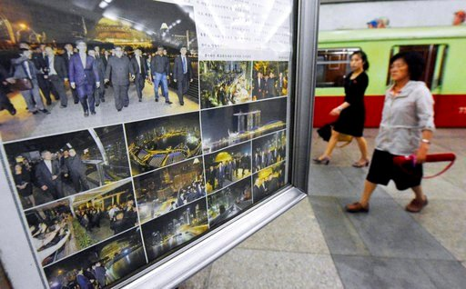 (Minoru Iwasaki/Kyodo News via AP, File). FILE - In this  June 12, 2018, fie photo, people walk past the display of local newspaper reporting North Korean leader Kim Jong Un 's tour of Singapore, at a subway station in Pyongyang, North Korea. The serie...