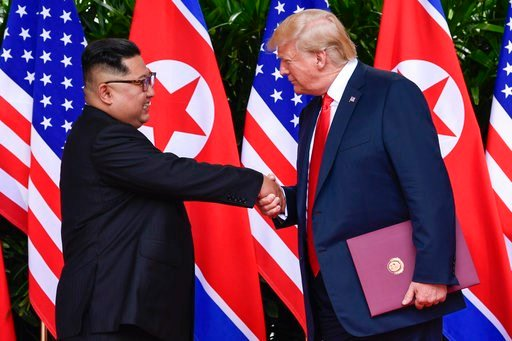 (AP Photo/Susan Walsh, Pool, Fie). FILE - In this June 12, 2018, file photo, North Korea leader Kim Jong Un, left, and U.S. President Donald Trump shake hands at the conclusion of their meetings at the Capella resort on Sentosa Island in Singapore. The...