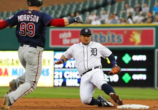 (AP Photo/Carlos Osorio). Detroit Tigers first baseman Miguel Cabrera slides into first after fielding the grounder hit by Minnesota Twins' Logan Morrison (99) for the out during the third inning of a baseball game Tuesday, June 12, 2018, in Detroit.