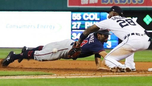 (AP Photo/Carlos Osorio). Minnesota Twins' Ryan LaMarre dives back to first as Detroit Tigers first baseman Niko Goodrum waits for the throw during the sixth inning of a baseball game Tuesday, June 12, 2018, in Detroit. LaMarre was out on the play.