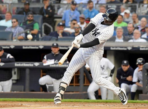 (AP Photo/Bill Kostroun). New York Yankees' Didi Gregorius hits a home run during the second inning of the team's baseball game against the Washington Nationals on Tuesday, June 12, 2018, at Yankee Stadium in New York.