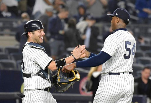(AP Photo/Bill Kostroun). New York Yankees catcher Austin Romine, left, and pitcher Aroldis Chapman congratulate each other after the Yankees defeated the Washington Nationals 3-0 in a baseball game Tuesday, June 12, 2018, at Yankee Stadium in New York.