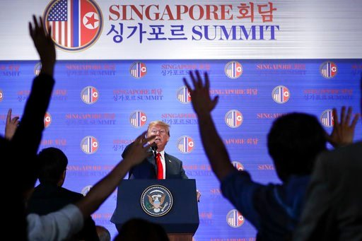 (AP Photo/Evan Vucci). U.S. President Donald Trump answers questions about the summit with North Korea leader Kim Jong Un during a press conference at the Capella resort on Sentosa Island Tuesday, June 12, 2018 in Singapore.