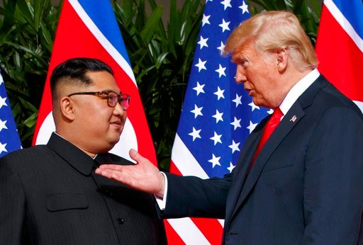 (AP Photo/Evan Vucci, File). FILE - In this June 12, 2018, file photo, U.S. President Donald Trump, right, meets with North Korean leader Kim Jong Un on Sentosa Island in Singapore. As soon as Kim steps off the airplane China provided him for the Singa...