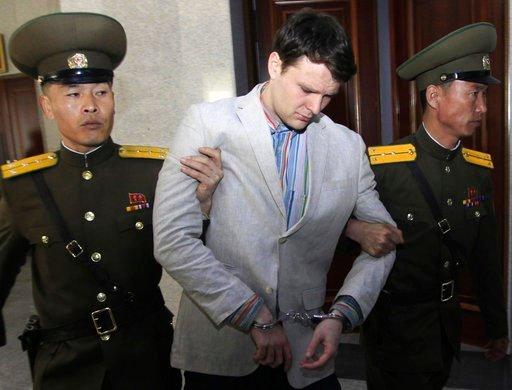 (AP Photo/Jon Chol Jin, File). In this March 16, 2016, file photo, American student Otto Warmbier, center, is escorted at the Supreme Court in Pyongyang, North Korea.