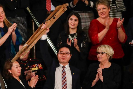 (AP Photo/J. Scott Applewhite. File). In this Jan. 30, 2018, file photo, Ji Seong-ho, a North Korean defector, holds up his crutches after his introduction by President Trump during the State of the Union address to a joint session of Congress.