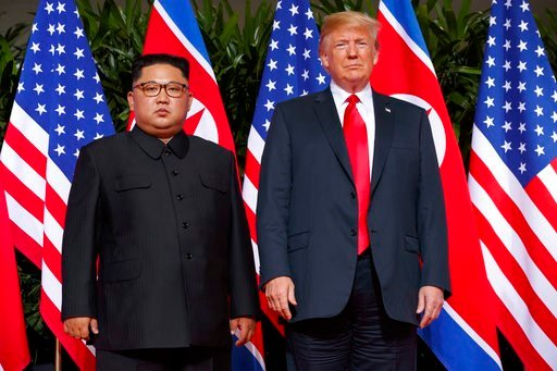 (AP Photo/Evan Vucci, File). In this June. 12, 2018, file photo, U.S. President Donald Trump meets with North Korean leader Kim Jong Un on Sentosa Island, in Singapore.