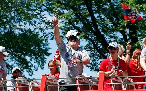 (AP Photo/Alex Brandon, Pool). Washington Capitals coach Barry Trotz tosses a strand of beads during a victory parade for the NHL hockey Stanley Cup champions Tuesday, June 12, 2018, in Washington.