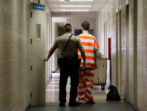 (AP Photo/Rich Pedroncelli, File). In this Feb. 21, 2013, file photo, an inmate at the Madera County Jail is taken to a housing unit at the facility in Madera, Calif.