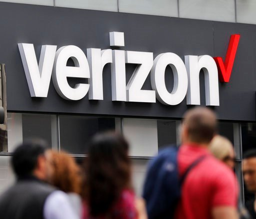 (AP Photo/Bebeto Matthews, File). In this Tuesday, May 2, 2017, file photo, Verizon corporate signage is captured on a store in Manhattan's Midtown area, in New York.