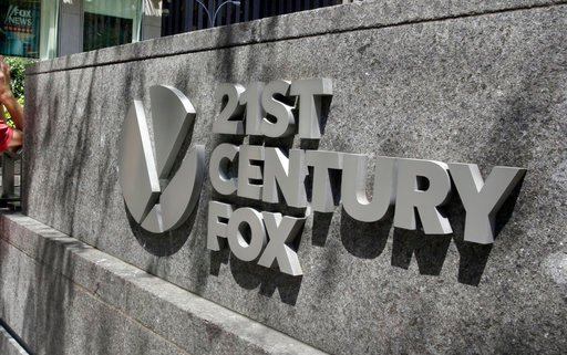 (AP Photo/Richard Drew, File). This Aug. 1, 2017, file photo shows the 21st Century Fox sign outside of the News Corporation headquarters building in New York.