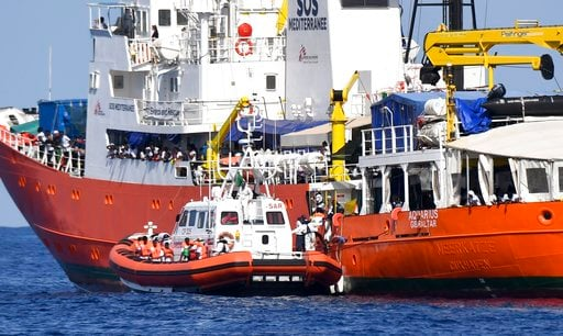 """(AP Photo/Salvatore Cavalli). An Italian Coast Guard boat approaches the French NGO """"SOS Mediterranee"""" Aquarius ship as migrants are being transferred, in the Mediterranean Sea, Tuesday, June 12, 2018. Italy dispatched two ships Tuesday to help take 62..."""