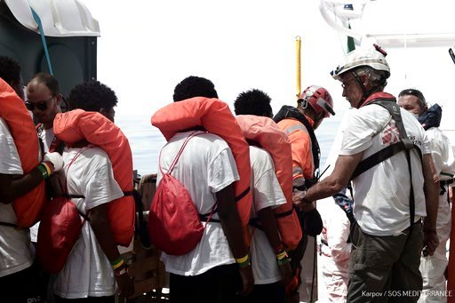 """(Kenny Karpov/SOS Mediterranee via AP). This undated photo released on Tuesday, June 12, 2018, by French NGO """"SOS Mediterranee"""", shows stranded migrants aboard the SOS Mediterranee's Aquarius ship and MSF (Doctors Without Borders) NGOs, as they are tra..."""