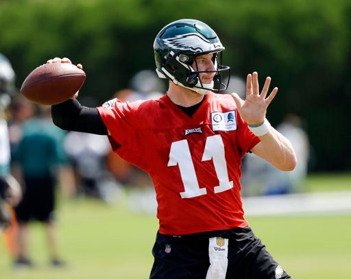 (AP Photo/Matt Slocum, File). FILE - In this Thursday, June 7, 2018, file photo, Philadelphia Eagles' Carson Wentz runs a drill during an organized team activity at the NFL football team's practice facility, in Philadelphia. Wentz was having an MVP sea...