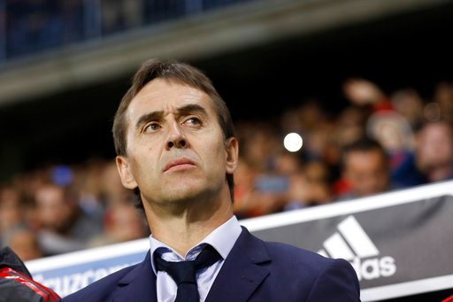 (AP Photo/Miguel Morenatti, File). FILE - In this Saturday, Nov. 11, 2017 filer, Spain coach Julen Lopetegui stands by the bench during the international friendly soccer match between Spain and Costa Rica in Malaga, Spain.