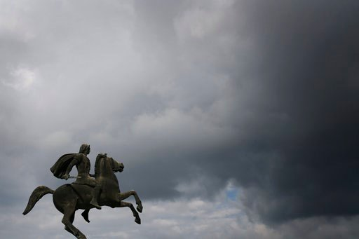 (AP Photo/Petros Giannakouris, File). FILE- In this Wednesday, Oct, 8, 2014 file photo, a modern bronze statue of Alexander the Great stands under the cloudy sky of the northern port city of Thessaloniki, Greece.  Officials in Greece and Macedonia say ...