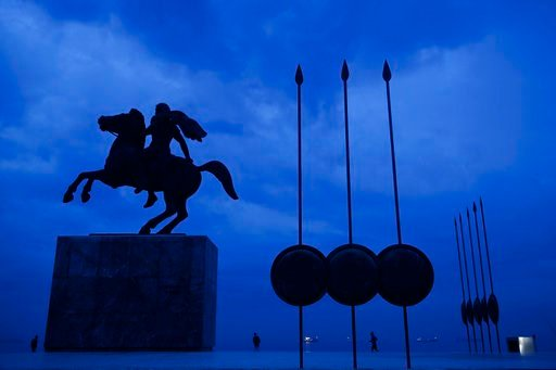 (AP Photo/Petros Giannakouris, File). FILE - In this Wednesday, Oct, 8, 2014 file photo, a modern bronze statue of Alexander the Great is flanked by copies of round shields and the Macedonian infantry's Sarissa pikes, in the northern port city of Thess...
