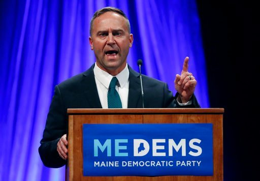 (AP Photo/Robert F. Bukaty, File). FILE - In this May 19, 2018 file photo, gubernatorial candidate Adam Cote speaks at the Democratic convention in Lewiston, Maine. Mainers go to the ballot box, Tuesday, June 12 to rank candidates for the first time. I...