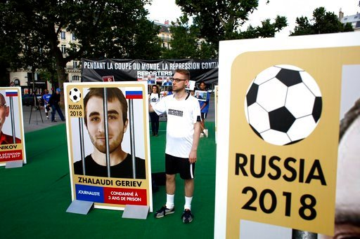(AP Photo/Thibault Camus). Members of Reporters Without Borders (RSF) hold giants portraits representing imprisoned Russian journalists, on the Place de la Republique, in Paris, Wednesday, June 13, 2018. French non-profit Reporters Without Borders set ...