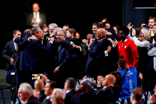 (AP Photo/Pavel Golovkin). Delegates of Canada, Mexico and the United States celebrate after winning a joint bid to host the 2026 World Cup at the FIFA congress in Moscow, Russia, Wednesday, June 13, 2018.
