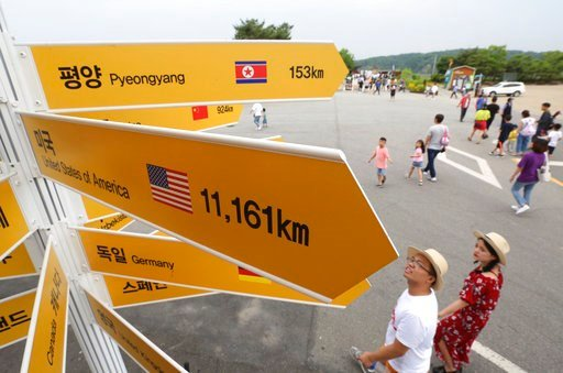 (AP Photo/Ahn Young-joon). Destination signs to North Korea's capital Pyongyang, top, and the United States, center, are seen at the Imjingak Pavilion in Paju near the border village of Panmunjom, South Korea, Wednesday, June 13, 2018. While South Kore...