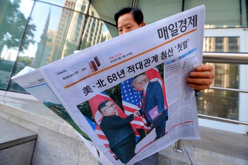 "(AP Photo/Ahn Young-joon). A man reads a newspaper reporting the summit between U.S. President Donald Trump and North Korean leader Kim Jong Un, at a newspaper distributing station in Seoul, South Korea, Tuesday, June 12, 2018. The headline read: "" Nor..."