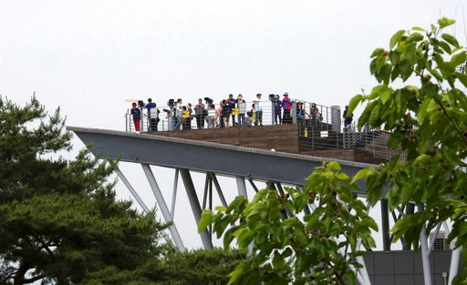 (AP Photo/Ahn Young-joon). Visitors look toward North's side at the Imjingak Pavilion in Paju near the border village of Panmunjom, South Korea, Wednesday, June 13, 2018. While South Koreans cheered with hope and China saw an opening to discuss lifting...