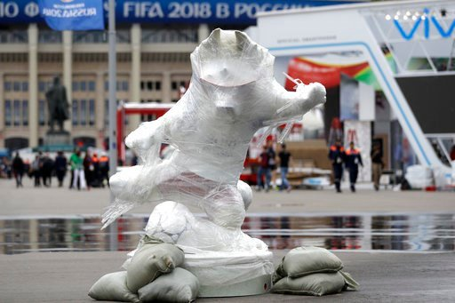 (AP Photo/Matthias Schrader). The official mascot Zabivaka stands wrapped outside the stadium after the official training session of the Russian team one the eve of the group A match between Russia and Saudi Arabia at the 2018 soccer World Cup at Luzhn...