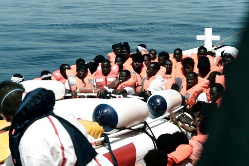 "(Kenny Karpov/SOS Mediterranee via AP). This undated photo released on Tuesday, June 12, 2018, by French NGO ""SOS Mediterranee"", shows stranded migrants aboard a Italian Coast Guard boat as they are transferred from the SOS Mediterranee's Aquarius ship..."