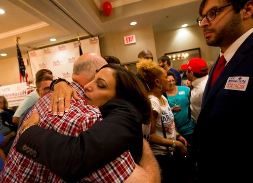 (Andrew Whitaker/The Post And Courier via AP). State Rep. Katie Arrington hugs supporters as she defeated U.S. Rep. Mark Sanford at the DoubleTree by Hilton Hotel for Katie Arrington's results party on Tuesday, June 12, 2018, in North Charleston, S.C.