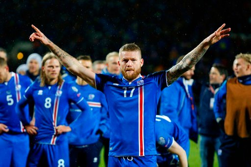 (AP Photo/Brynjar Gunnarsson, File ). FILE - In this Monday Oct. 9, 2017 filer, Iceland's captain Aron Gunnarsson celebrates at the end of the World Cup Group I qualifying soccer match between Iceland and Kosovo in Reykjavik, Iceland. Icelandic footbal...