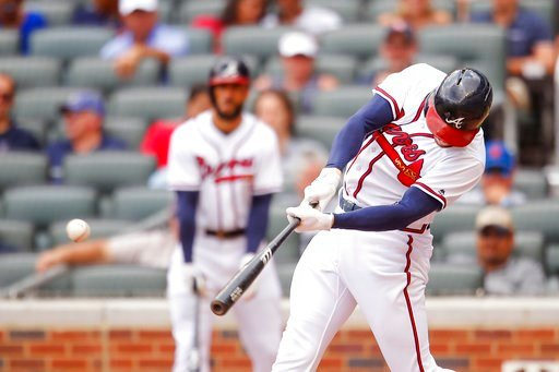 (AP Photo/Todd Kirkland). Atlanta Braves Freddie Freeman hits a single to bring in a run in the fourth inning of a baseball game against the New York Mets, Wednesday, June 13, 2018, in Atlanta.
