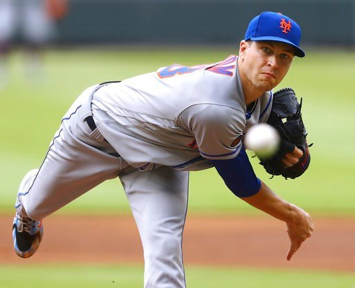 (Curtis Compton/Atlanta Journal-Constitution via AP). New York Mets pitcher Jacob deGrom throws against the Atlanta Braves during the first inning of a baseball game Wednesday, June 13, 2018, in Atlanta.