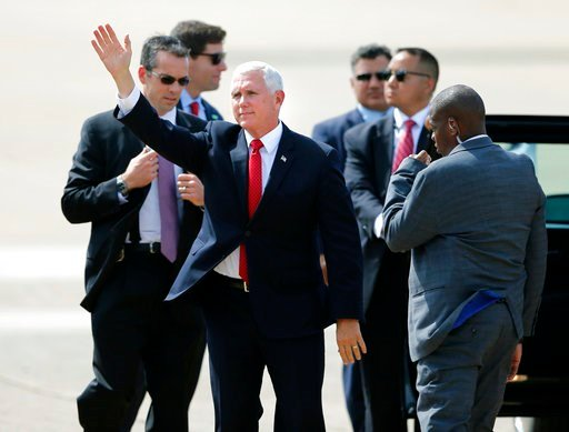 (Vernon Bryant/The Dallas Morning News via AP). Vice President Mike Pence waves after arriving at Dallas Love Field in Dallas on Wednesday, June 13, 2018. Pence is headed to the Kay Bailey Hutchison Dallas Convention Center to speak at the annual meeti...
