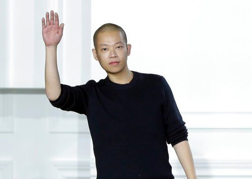 (AP Photo/Richard Drew, File). FILE - In this Feb. 13, 2015 file photo, designer Jason Wu acknowledges audience applause after his Fall 2015 collection was modeled during Fashion Week, in New York. The packaging for his namesake eau de parfum was nomin...