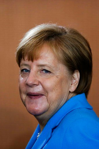 (AP Photo/Markus Schreiber). German Chancellor Angela Merkel arrives for the weekly cabinet meeting of the German government at the chancellery in Berlin, Wednesday, June 13, 2018.