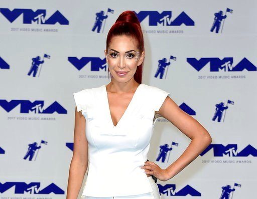 (Photo by Jordan Strauss/Invision/AP, File). FILE - In this Aug. 27, 2017 file photo, Farrah Abraham arrives at the MTV Video Music Awards in Inglewood, Calif. Police say the former reality TV star has been arrested after attacking a security guard at ...