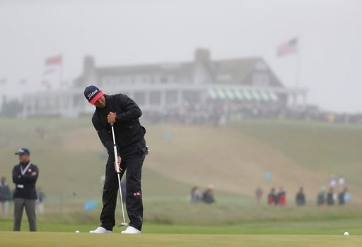 (AP Photo/Julio Cortez). Adam Scott, of Australia, putts on the first green during a practice round for the U.S. Open Golf Championship, Wednesday, June 13, 2018, in Southampton, N.Y.