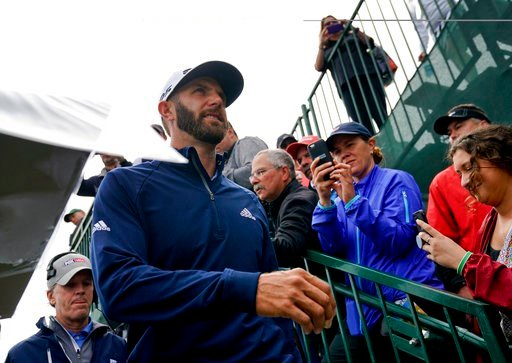 (AP Photo/Carolyn Kaster). Dustin Johnson heads for the 14th tee during a practice round for the U.S. Open Golf Championship, Wednesday, June 13, 2018, in Southampton, N.Y.