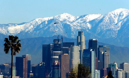 (AP Photo/Nick Ut, File). File - In this Jan. 12, 2016 file photo, the snow-capped San Gabriel Mountains stand as a backdrop to the downtown Los Angeles skyline. An initiative that seeks to split California into three states is projected to qualify for...