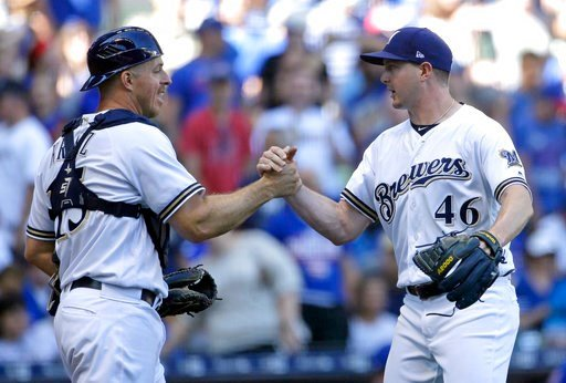 (AP Photo/Aaron Gash). Milwaukee Brewers' Corey Knebel (46) is congratulated by Erik Kratz after recording a save after a baseball game against the Chicago Cubs Wednesday, June 13, 2018, in Milwaukee. The Brewers won 1-0.