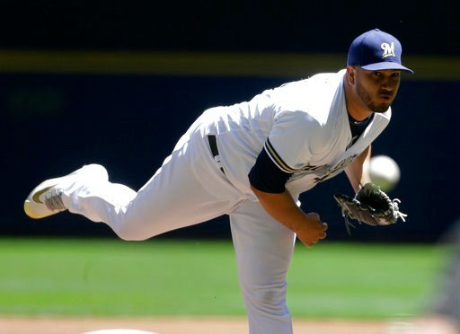 (AP Photo/Aaron Gash). Milwaukee Brewers' Jhoulys Chacin pitches during the first inning of a baseball game against the Chicago Cubs Wednesday, June 13, 2018, in Milwaukee.