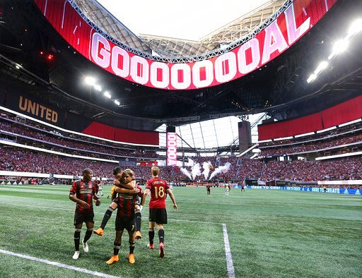 (Curtis Compton/Atlanta Journal-Constitution via AP, File). FILE - In this June 2, 2018, file photo, the roof of Mercedes-Benz Stadium is open as Atlanta United forward Josef Martinez celebrates his goal against the Philadelphia Union on a penalty kick...