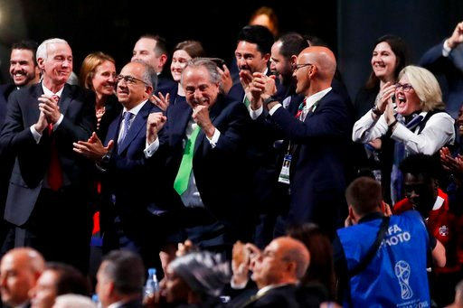 (AP Photo/Pavel Golovkin). Delegates of Canada, Mexico and the United States celebrate after winning a joint bid to host the 2026 World Cup at the FIFA congress in Moscow, Russia, Wednesday, June 13, 2018. Standing on front row from left: Steve Reed, p...