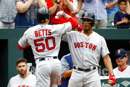 (AP Photo/Patrick Semansky). Boston Red Sox's Xander Bogaerts, right, greets teammate Mookie Betts after Betts rounded the bases on a solo home run in the third inning of a baseball game against the Baltimore Orioles, Wednesday, June 13, 2018, in Balti...
