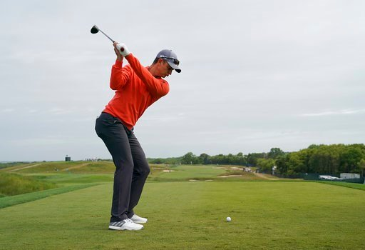 (AP Photo/Carolyn Kaster). Justin Rose, of England, drives off the 12th tee during a practice round for the U.S. Open Golf Championship, Wednesday, June 13, 2018, in Southampton, N.Y.